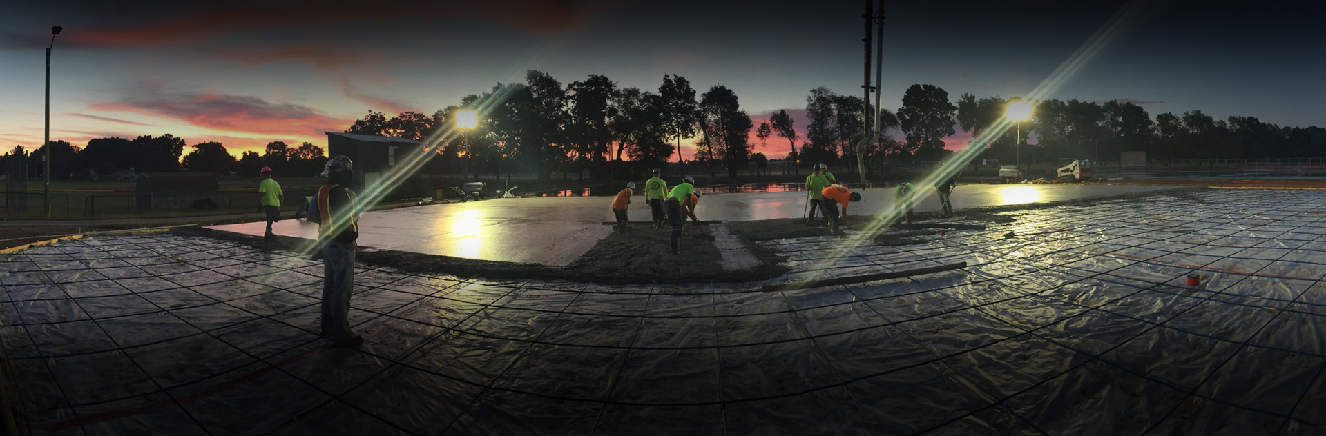 Concrete being poured for tennis courts
